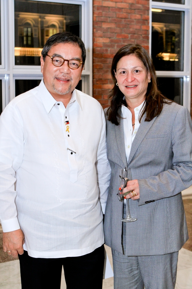 Department of Tourism Secretary Ramon Jimenez, Jr. and Tourism Congress of the Philippines president Rosana Fores