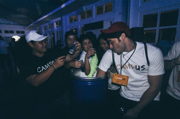 Excited students huddle to get their free Red Bull. (Photo by Dany Papio)