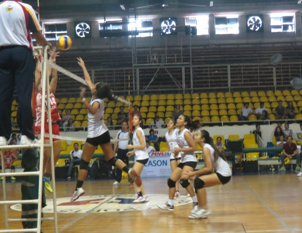 Lady titans scoring against San Beda.