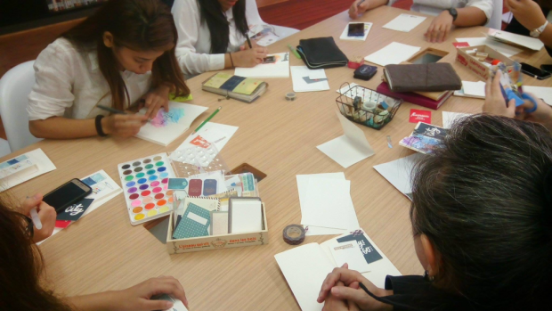 Participants get busy in designing their own journals