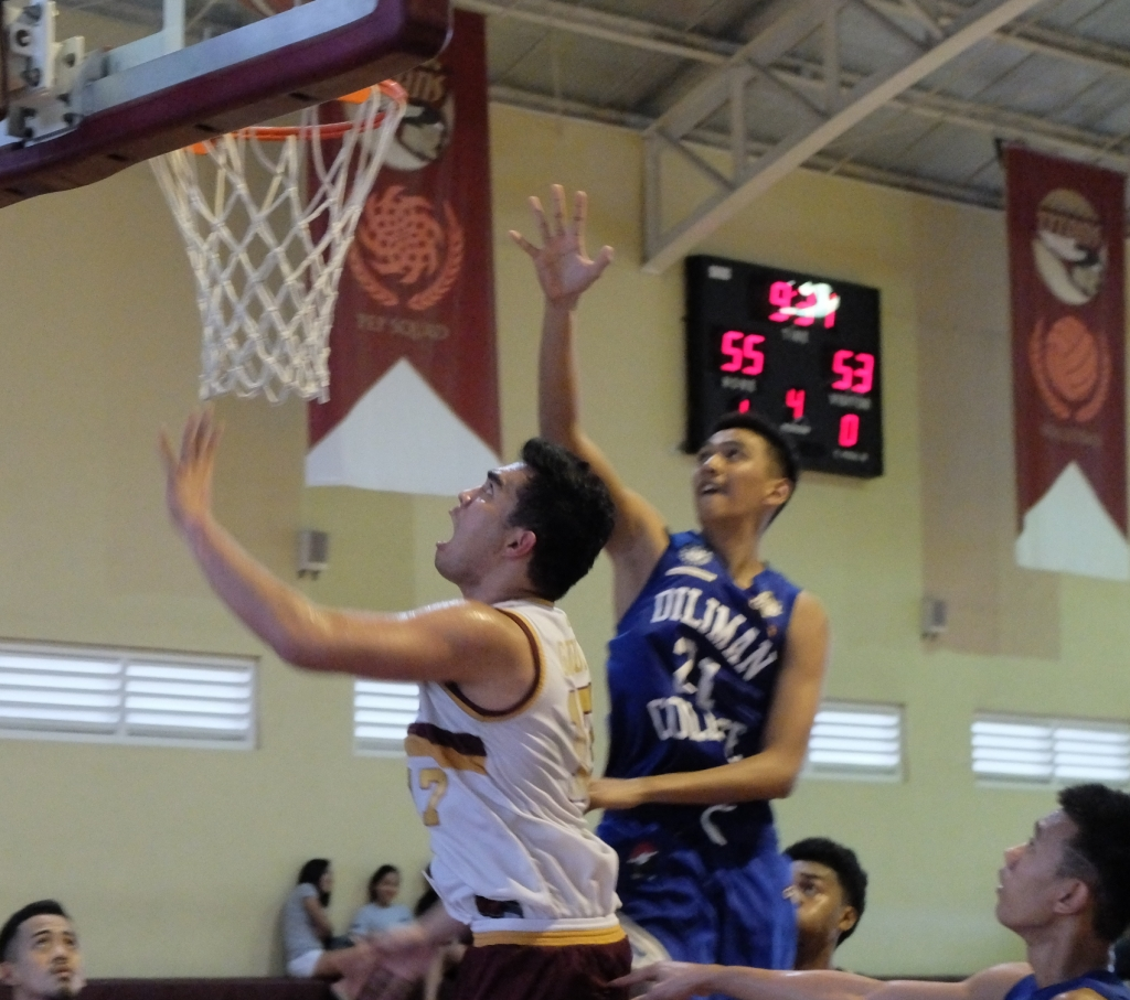 Captain Mark Gatula scores over Blue Dragon Guard Sombrero to lead 55 to 53.
