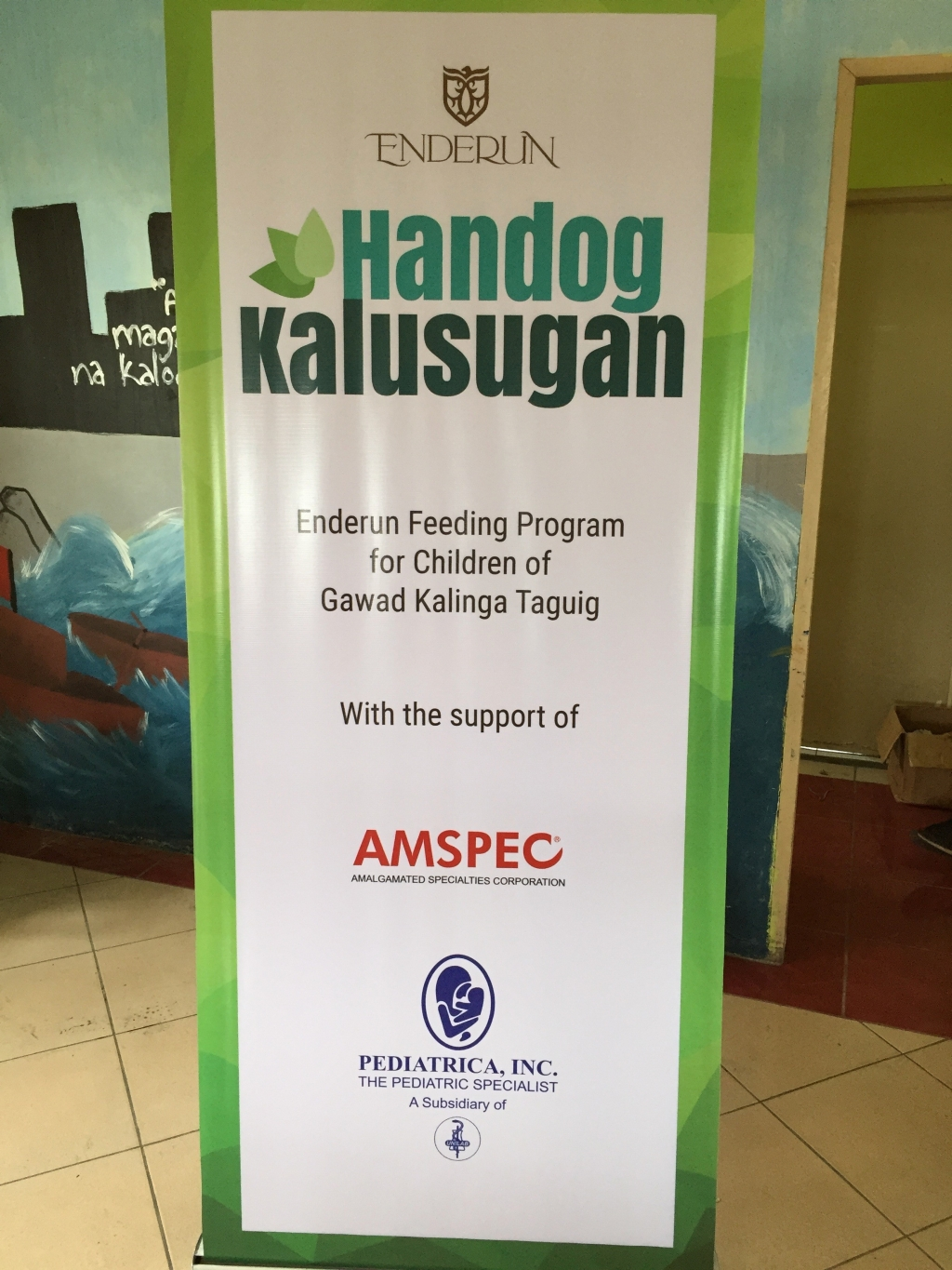 Handog Kalusugan, a feeding program led by Enderun Colleges with the support of Amalgamated Specialties Corporation and Pediatrica, Inc.