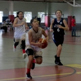 Shaina Marcos goes in for the layup
