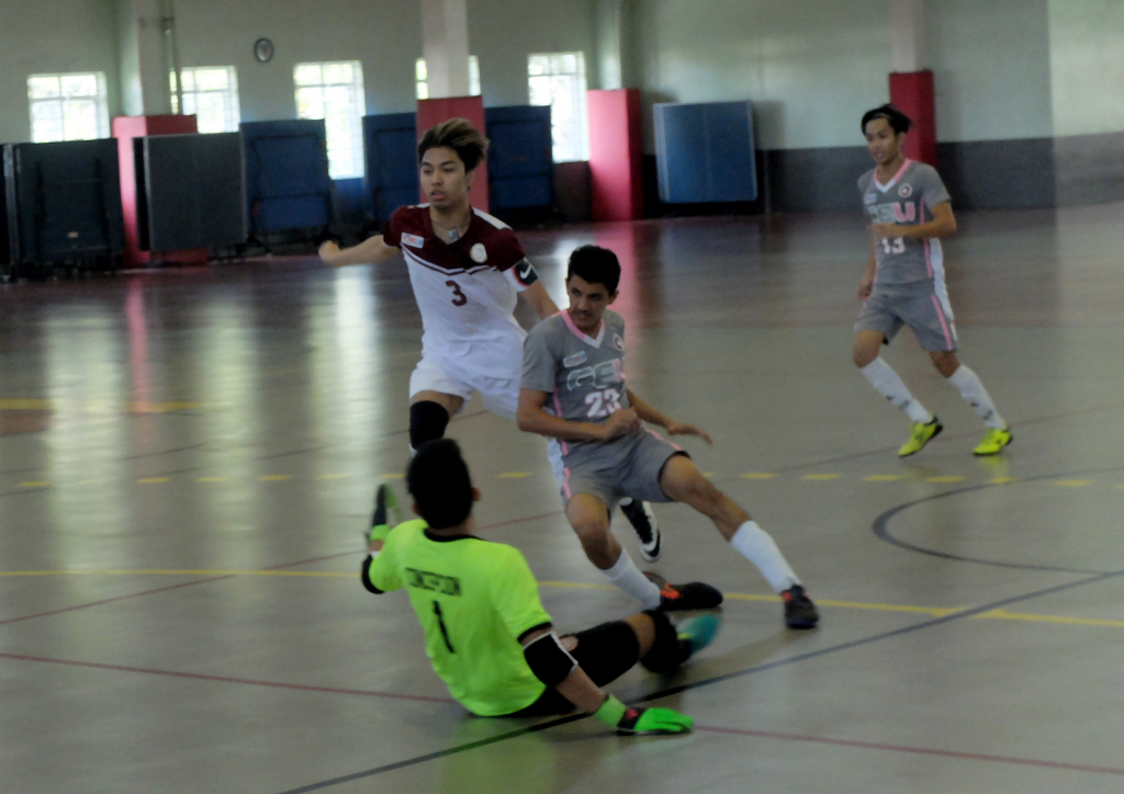 Caluag and goalie Concepcion stop CEU's star player and sole scorer, Ahmed