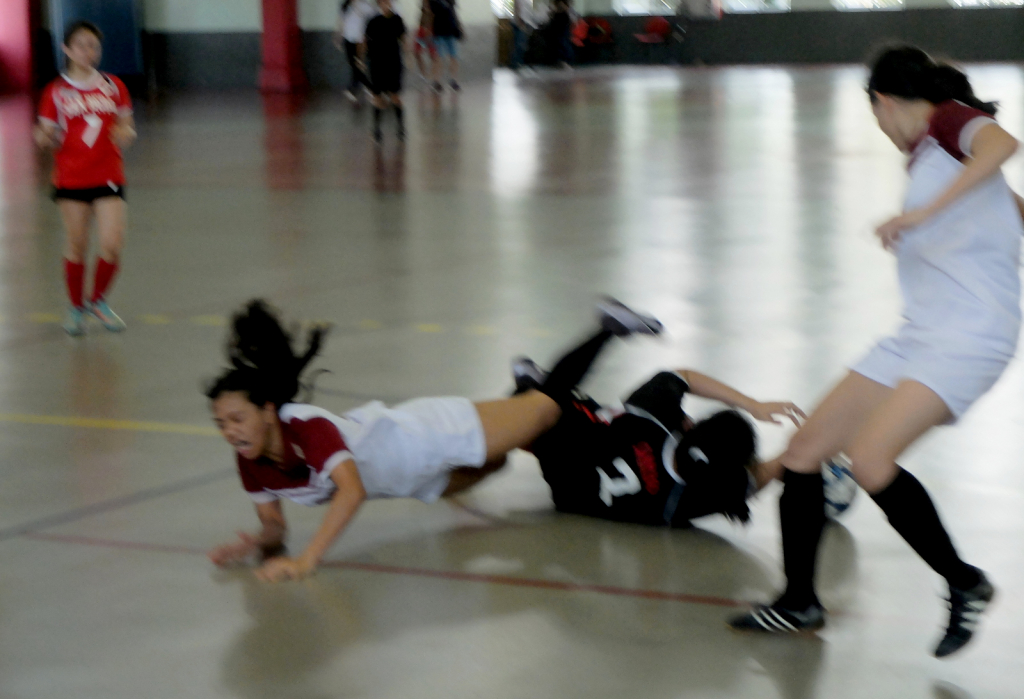 Cristel Seed takes a bad fall, as CEU goal keeper seeks to recover.
