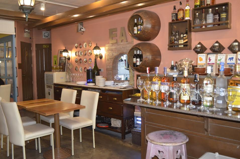Colorful wine bottles and beverages punctuate the Mediterranean interior, Croque has a variety of liquors and a rich wine cave.