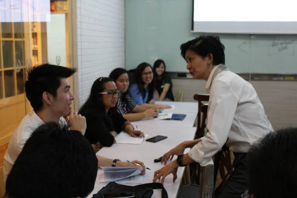 Whether it be in a class or a seminar, the typical Ms Marivic Ignacio engages her students in a lively discussion.