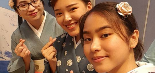 Alex Sato does the Korean heart sign with her new friends
