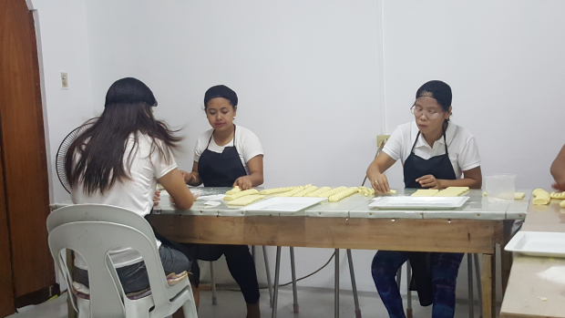 Female workers make pastillas by hand labor