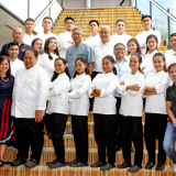 "Youth With A Future Batch 4 graduates together with Enderun Colleges Culinary Head Chef See Cheong Yan (second row, 5th from left) and Tuloy Foundation President and Project Director Fr. Marciano ""Rocky"" Evangelista, SDB (second row, 4th from left), and other Ducasse Education chef instructors."