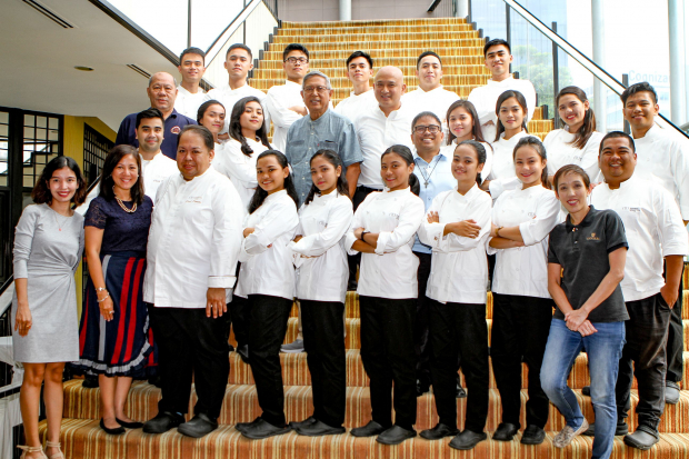 """Youth With A Future Batch 4 graduates together with Enderun Colleges Culinary Head Chef See Cheong Yan (second row, 5th from left) and Tuloy Foundation President and Project Director Fr. Marciano """"Rocky"""" Evangelista, SDB (second row, 4th from left), and other Ducasse Education chef instructors."""
